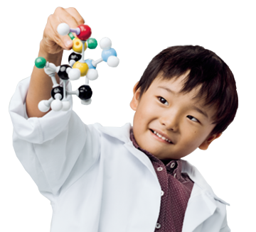 Young boy playing the 3D model of molecular strand